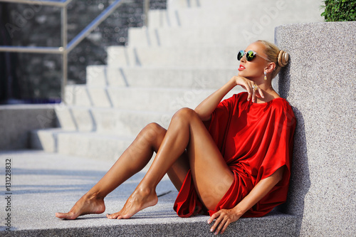 Fashion portrait of young magnificent woman in red dress Fotobehang