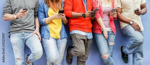 Fototapeta Group of multiracial students watching smart mobile phones obraz