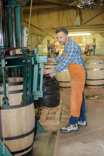 Fotografie, Obraz  cooper making wooden wine barrels in workshop