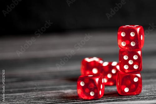 фотография  concept luck - dice gambling on dark wooden background