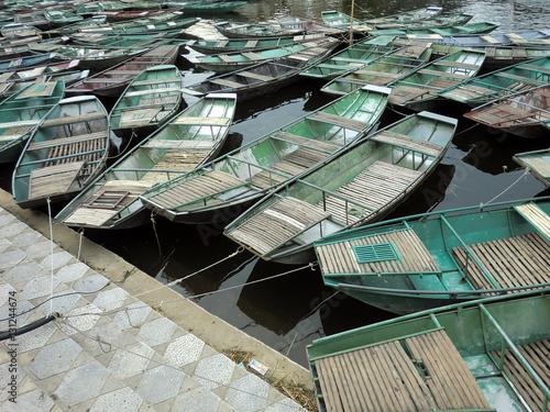 Fotografie, Obraz  Many flat rowboats on Vietnam river dock