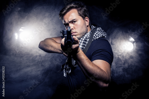 Fotografie, Obraz  Soldier or mercenary wearing a shemagh with assault rifle, paintball or airsoft gun