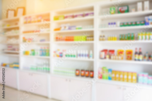 Poster Pharmacie pharmacy shelves filled with medication blur background