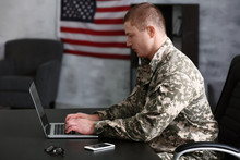 Soldier Working With Laptop In...