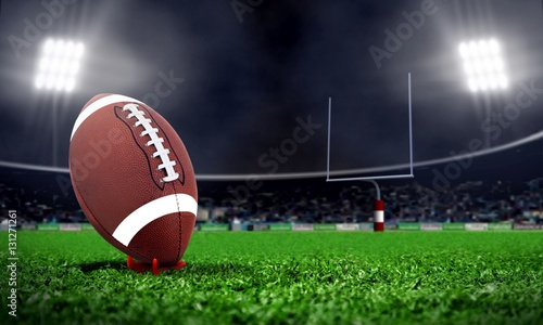 Fototapeta American football in stadium at night with spotlight obraz