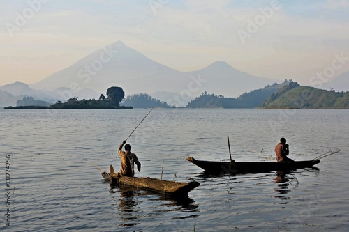 Fishermen and workers in african congo, wild and nature in africa, beautiful landscape view, green jungle and mountains