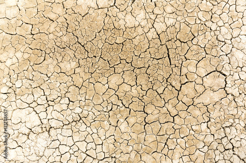 Canvas Print Dried and cracked sandy soil from a drained desert lakebed