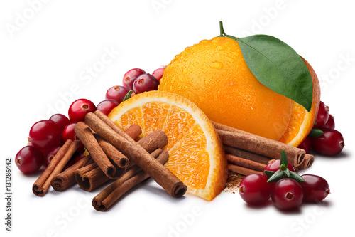 Fototapeta Orange with cranberry, cinnamon sticks, paths obraz