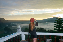 Woman Look Sunrise And The Mist With Mountain Background , Lands