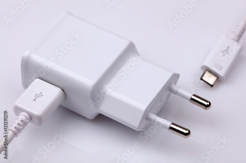 Foto Cell, smart phone, mobile power charger on white background.