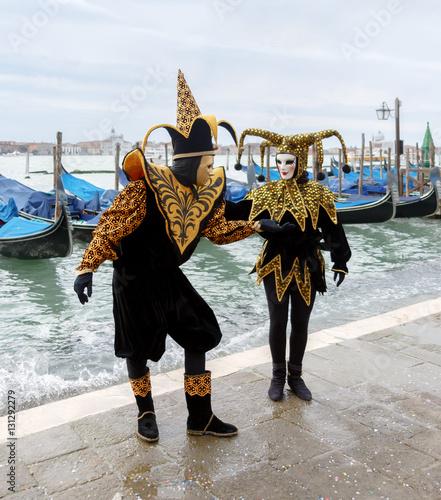 Fototapeta VENICE, ITALY - MAR 04, 2014: Unrecognizable persons wearing carnival costume (mask) in Saint Mark square in Venice, Italy. In 2014 the Carnevale di Venezia was held between 15 Feb - 04 Mar