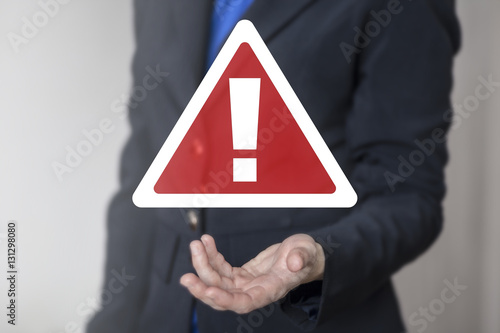 Foto Business attention mark with triangle icon web internet communication risk safet
