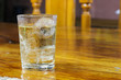 Drinking water in the glass on a wooden table.