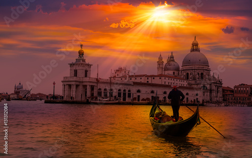 Wall Murals Gondolas Venetian gondolier punting gondola through green canal waters of Venice Italy