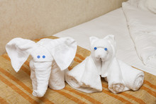 Folded Towel Animals On Bed In...