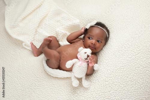 Newborn Baby Girl with Stuffed Bear Canvas Print