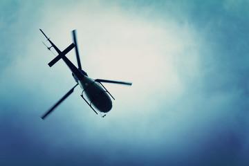 Fototapeta Helicopter flying in the blue sky