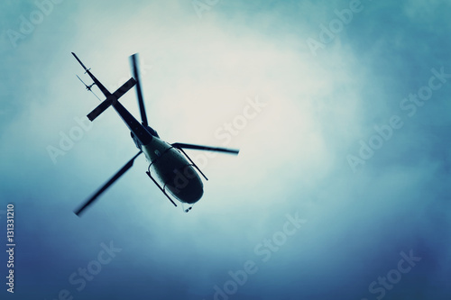 Foto op Plexiglas Helicopter Helicopter flying in the blue sky