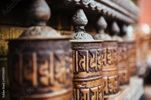 Stampa su Tela  Prayer wheels at Buddhist temple