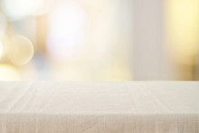 Empty Table With Linen Tablecloth Over Blurred Store With Bokeh