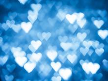 Blue Heart Bokeh Christmas Light Holiday Background.