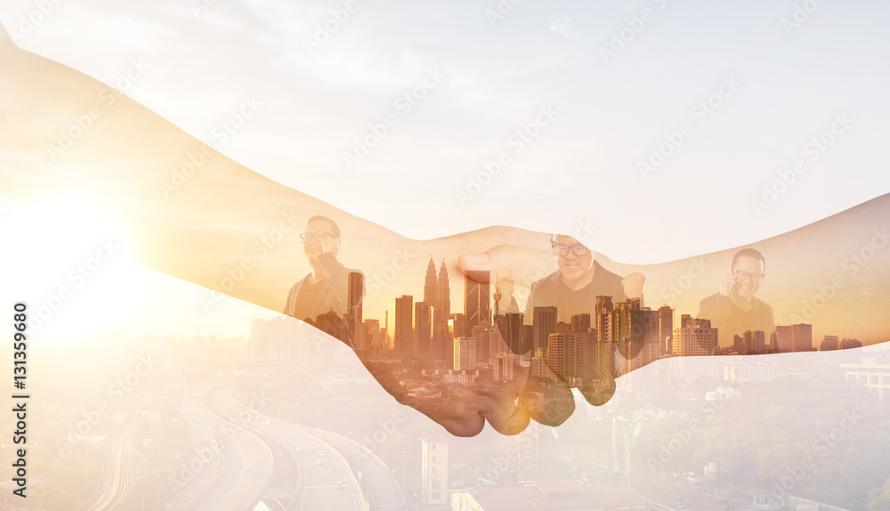 Fototapety, obrazy: Double exposure of Partners shaking hands .