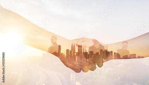Pinturas sobre lienzo  Double exposure of Partners shaking hands .