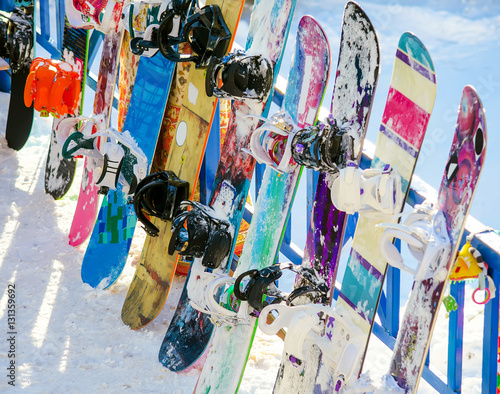 several snowboards are about fencing