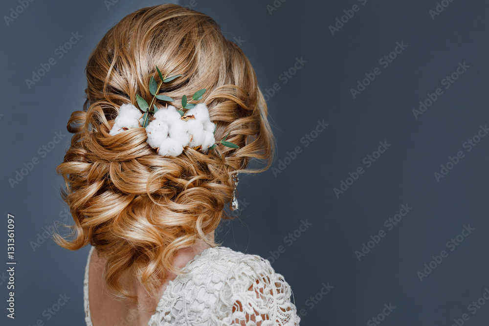 Fototapeta beauty wedding hairstyle decorated with cotton flower, rear view