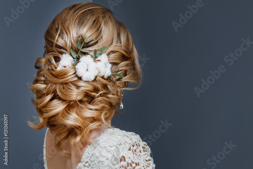 Fotobehang Kapsalon beauty wedding hairstyle decorated with cotton flower, rear view