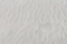 Next In Shape Of Heart On White Sand