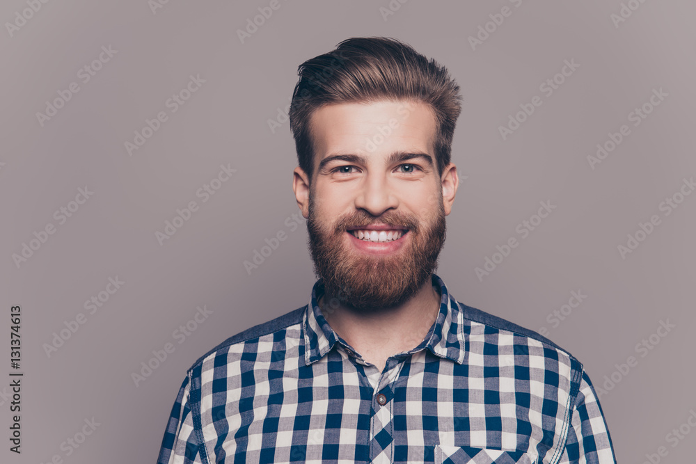 Fototapeta portrait of handsome smiling young man looking at camera isolate
