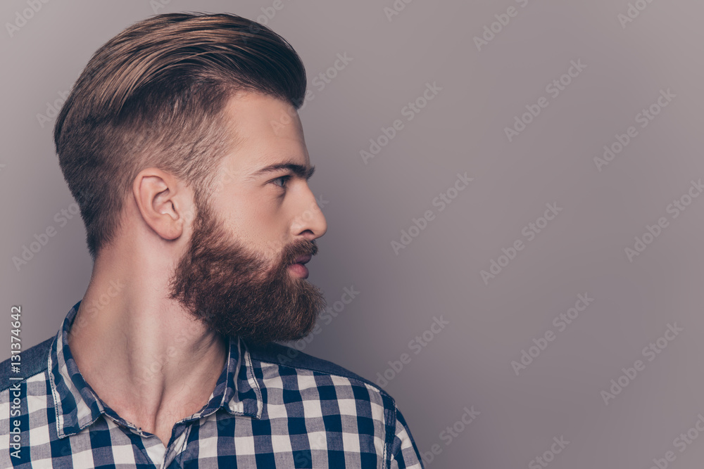 Fototapeta Side view portrait of thinking stylish young man looking away