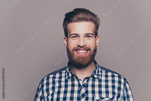 Obraz portrait of handsome smiling young man looking at camera isolate - fototapety do salonu