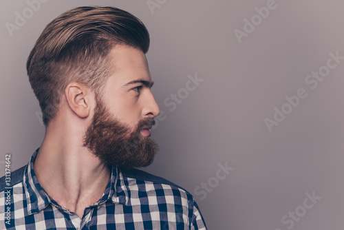 Foto auf Leinwand Friseur Side view portrait of thinking stylish young man looking away