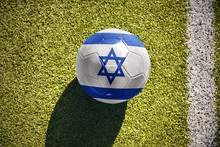 Football Ball With The National Flag Of Israel Lies On The Field