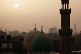Sunset in dusty Cairo with mosque and minaret