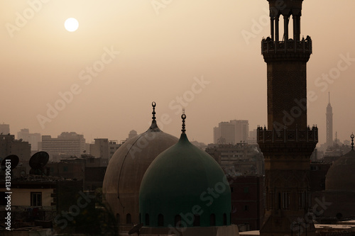 Obraz na płótnie Sunset in dusty Cairo with mosque and minaret