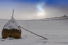 Lonely Mop Of Hay Covered With Snow