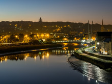 Lancaster City At Dawn Over River Lune With Sunrise Glow And Street Lights Sparkling
