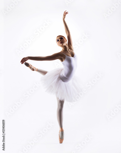 Fotografie, Obraz  Young beautiful ballet dancer on a white background