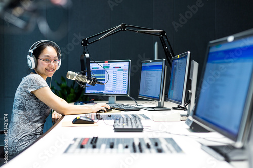 young woman dj works in modern broadcast studio Canvas Print