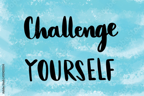 Fotografia Challenge yourself motivational message over blue painted background