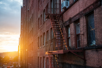 Fototapeta Fire Escape stairs on the building wall in New York City