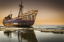 Rusty Shipwreck On Beach Greece