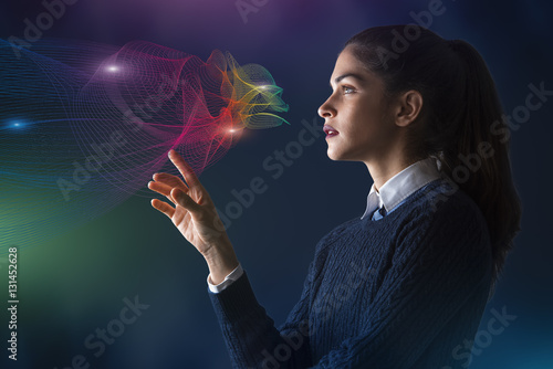 canvas print motiv - PhotoPlus+ : concept of a young woman selecting colors on projected rainbow color spectrum vector lines of cloud shape
