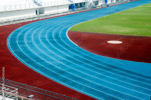 Foto op Plexiglas Stadion Blue running track in stadium. running track line.