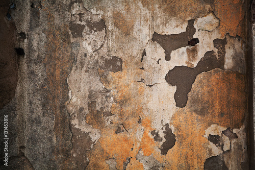 Deurstickers Oude vuile getextureerde muur Texture a dark dingy stone surface. Shabby grungy background. Peels the old paint off the wall. Rough concrete texture.