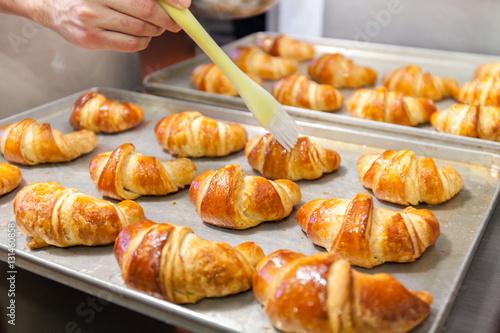 Detail of Hands preparing french croissant in colour Fototapeta