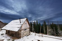 Wooden House In Winter In A Fo...